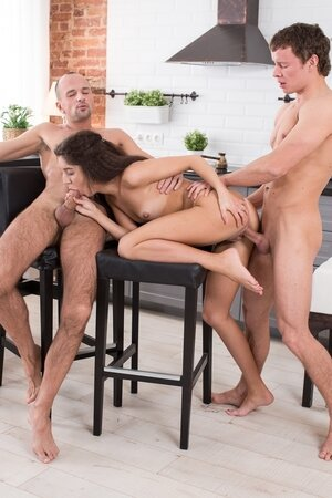 Love has threesome sex making guys profusely cum on her face in the kitchen