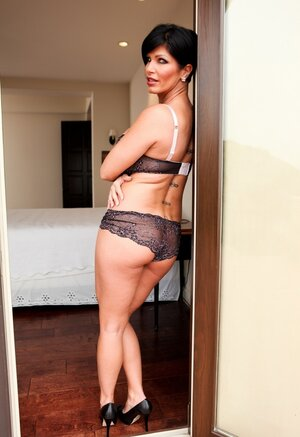 Brunette woman with short hair looks so seductive wearing this underwear