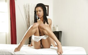 Chocolate 18-19 y.o. takes off her clothes and besides waits for masseur completely undressed