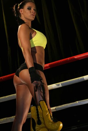 Yellow boxing gloves aren't MILF's general weapon cause she has large milk sacks