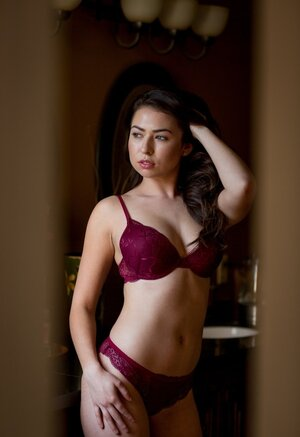 Drop-dead cute lady Melissa Moore caresses herself in luxurious lingerie