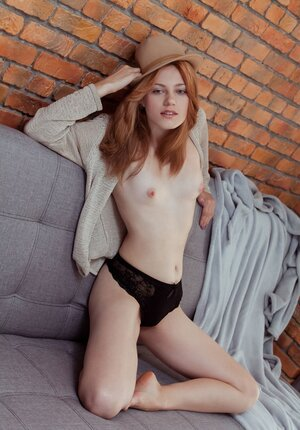 Red-haired sexpot Shirley Tate exposes her petite assets in spacious studio