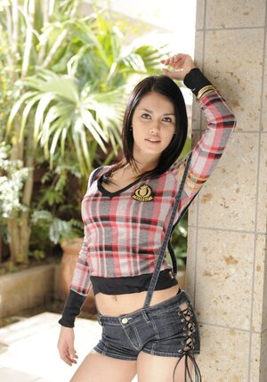 Charming Asian woman Maria Ozawa goes outdoors to pose seductively on terrace