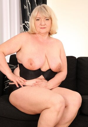 Grown-up Adult bbw with big saggy breasts spreads overweight between legs to show stretched cunt