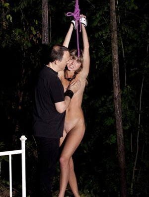 Dude brings slim sweetie to the forest under cover of darkness for BDSM