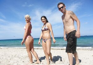 Erotically attractive girls in bikinis like to spend good time and pose on the beach