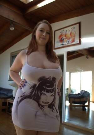 Sex goddess with splendid breasts exposes charms changing her clothes