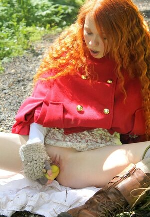 Petite Red Riding Hood lost in the woods using banana to masturbate vagina