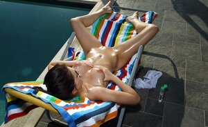 Hoe plays dirty games on the chaise lounge getting naked in front of another dame