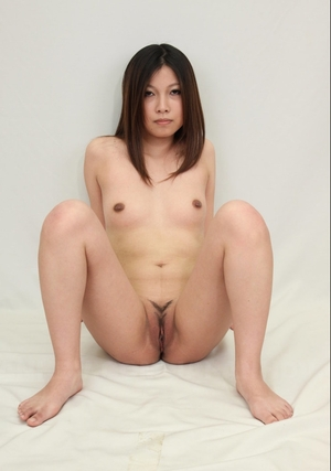 Obedient Far eastern girl stays naked in studio exposing her perky jugs and moreover clit
