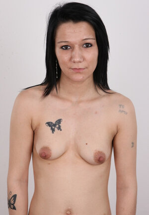 Fascinating brunette with little boobies unclothes in front of the camera