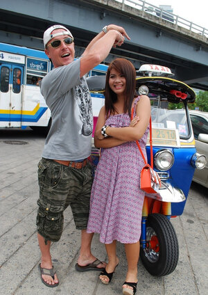 Oriental legal teen Tukta with red hair wears sexy violet dress and besides prefers Tuk Tuk taxi