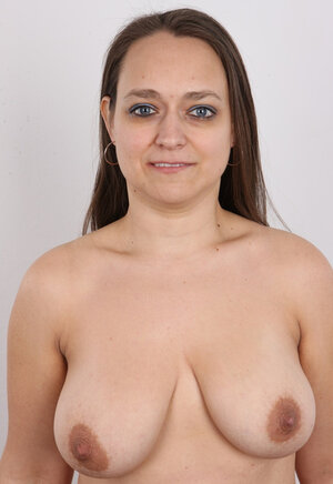 Female turns photoshoot into dirty striptease exposing different-shaped breasts